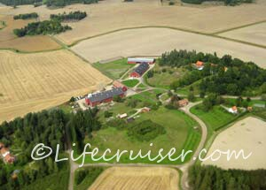 Typical Falu red Swedish farm from air
