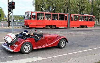 Estonia, Tallinn: red classic car and tram meet