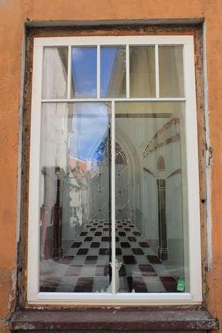 Estonia, Tallinn Old Town: Reflection in illusionary window
