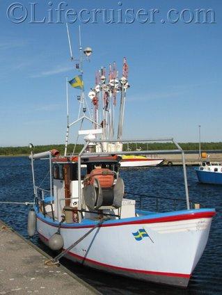 Fårö fishing-boat with Swedish flag, Gotland, Sweden