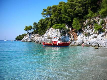 Greece, Skopelos Island: Small red boat at Kastani beach