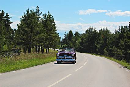 Sweden, Gotland: classic car on road